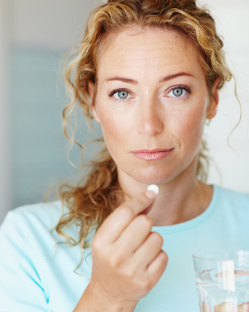 woman-taking-otc-drug-vert